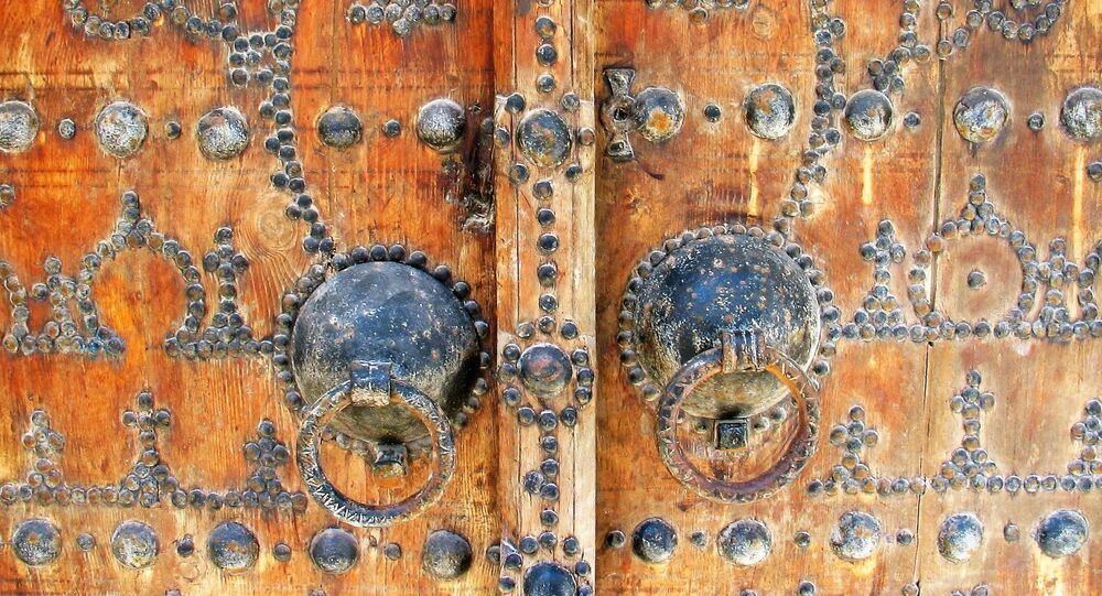 Porte arabesques