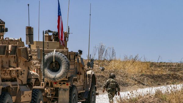 Armoured vehicles of the US-led coalition patrol the city of Ras al-Ain in Syria's Hasakeh province on July 28, 2019. - Sputnik France