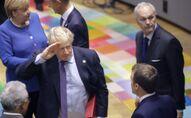 British Prime Minister Boris Johnson salutes French President Emmanuel Macron
