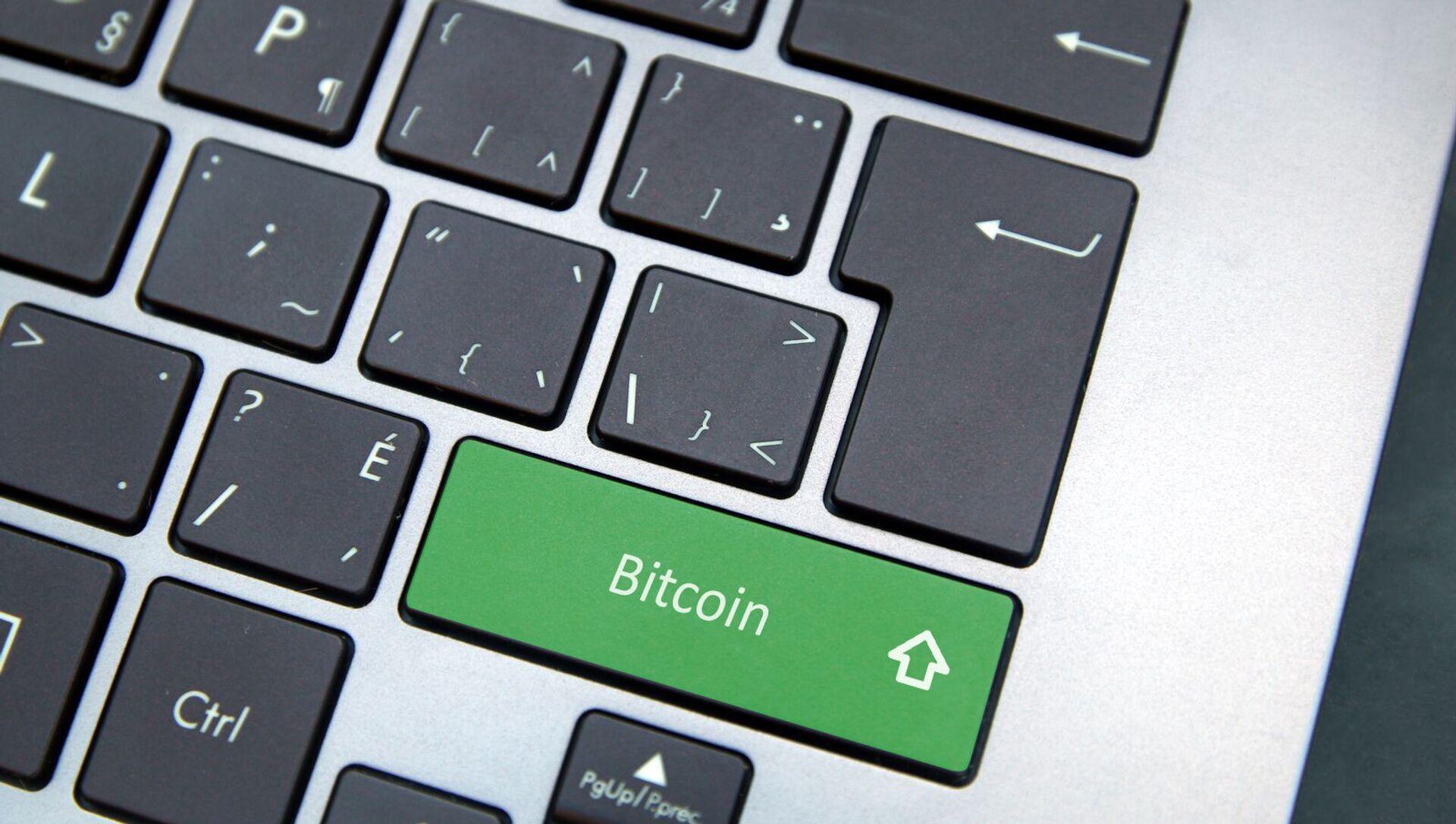Bouton «Bitcoin» sur un clavier d'ordinateur - Sputnik France, 1920, 13.02.2021