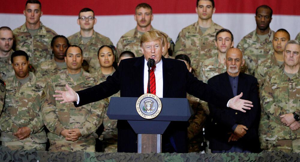 U.S. President Donald Trump delivers remarks to U.S. troops, with Afghanistan President Ashraf Ghani standing behind him, during an unannounced visit to Bagram Air Base, Afghanistan, November 28, 2019. REUTERS/Tom Brenner