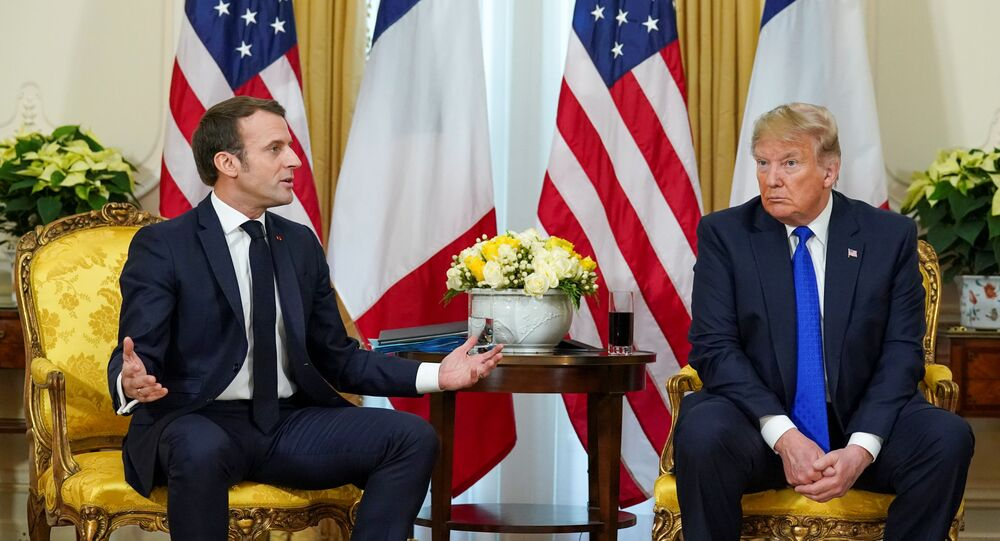 U.S. President Donald Trump looks on as France's President Emmanuel Macron talks, during a meeting ahead of the NATO summit in Watford, in London, Britain, December 3, 2019