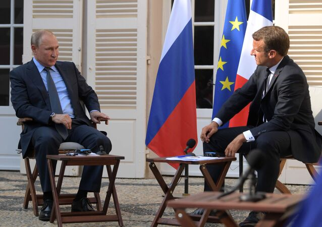Vladimir Poutine et Emmanuel Macron (photo d'archives)