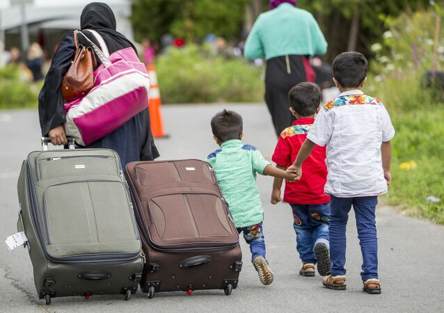 Demandeurs d'asile sur le chemin Roxham, près de la frontière américano-canadienne, 6 août 2017