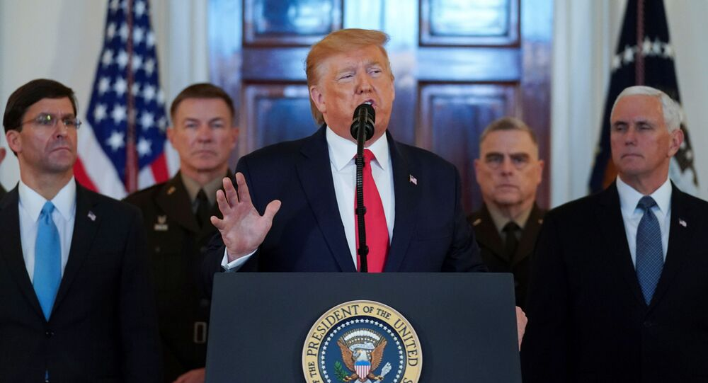 U.S. President Donald Trump delivers a statement about Iran flanked by U.S. Secretary of Defense Mark Esper, Vice President Mike Pence and military leaders in the Grand Foyer at the White House in Washington, U.S., January 8, 2020.