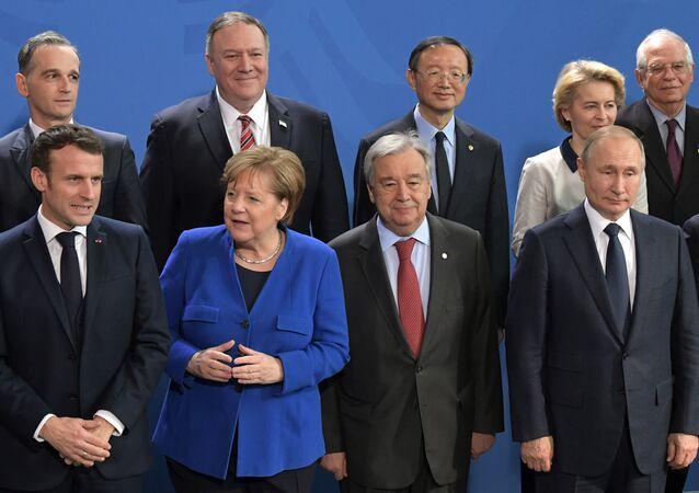 Vladimir Poutine, Angela Merkel et Antonio Guterres à Berlin, le 19 janvier 2020.