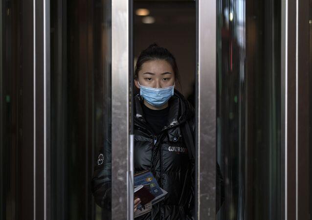 Une passagère d'un vol en provenance de Pékin (archive photo)