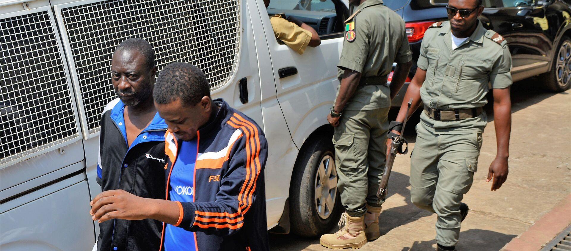 Des hommes arrêtés par la police au Cameroun. - Sputnik France, 1920, 14.02.2020