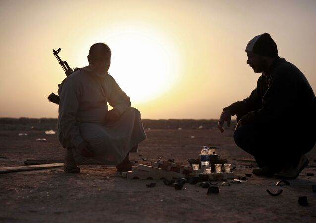 Des combattants de l'opposition à la périphérie de la ville libyenne d'Ajdabiya, en 2011 (photo d'archives)