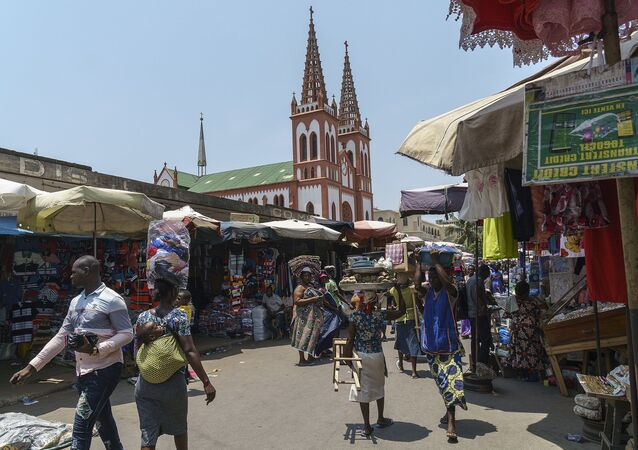 The Lomé Grand Marché with the Cathédrale du Sacré Coeur. Lomé, Togo