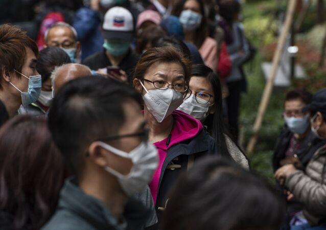 Une file d'attente à Hong Kong pendant l'épidémie de coronavirus