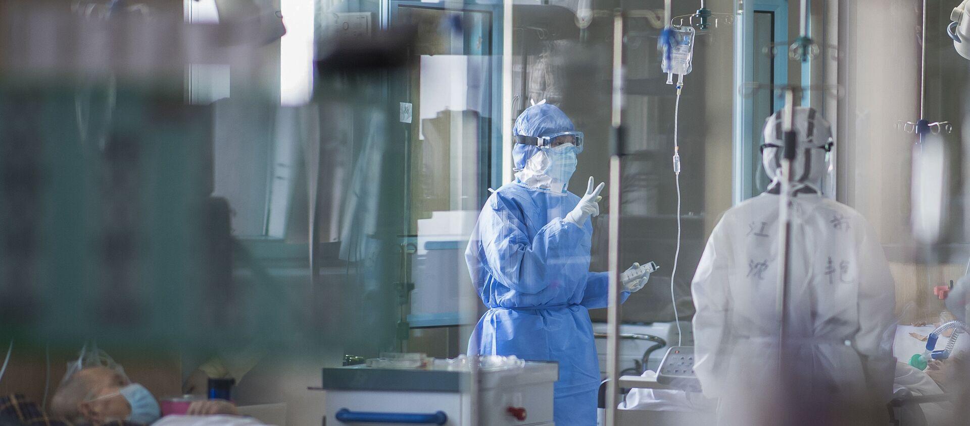 Des malades du Covid-19 dans un hôpital à Wuhan - Sputnik France, 1920, 07.07.2021