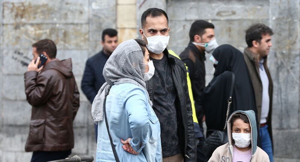 Iranian family wear protective masks to prevent contracting a coronavirus, as they stand at Grand Bazaar in Tehran, Iran February 20, 2020.