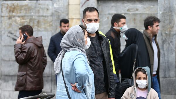 Iranian family wear protective masks to prevent contracting a coronavirus, as they stand at Grand Bazaar in Tehran, Iran February 20, 2020.  - Sputnik France