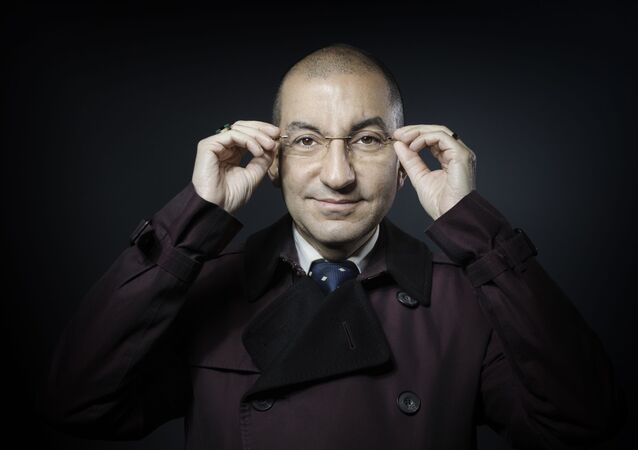 Jean Messiha, coordinator of the National Front for the Presidential Project and animator of the Circle of Horace, a group close to the National Front composed of senior officials, former cabinet chiefs, Companies, lawyers, magistrates and journalists, poses for a photograph in Paris on January 10, 2017. (Photo by JOEL SAGET / AFP)