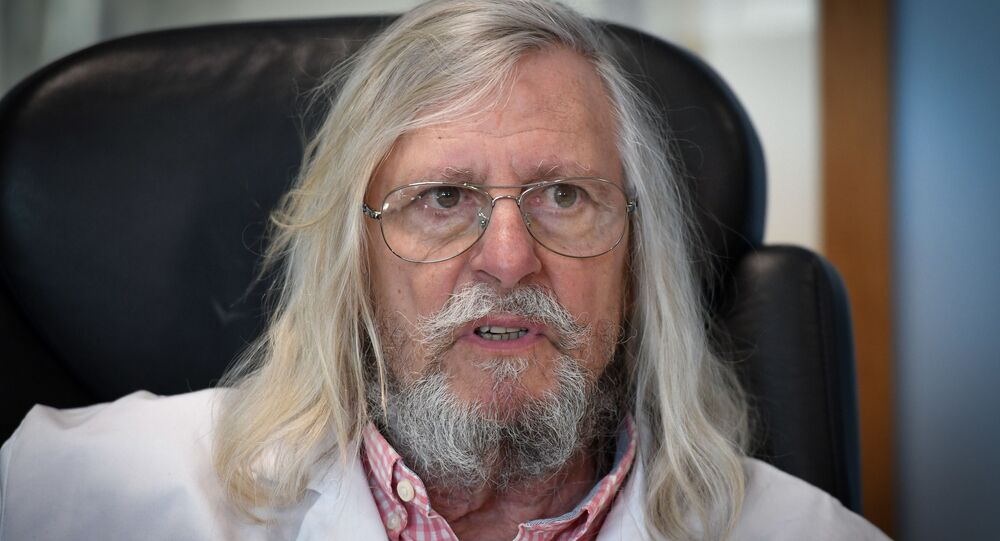 In this file photo taken on February 26, 2020 French professor Didier Raoult, biologist and professor of microbiology, specialized in infectious diseases and director of IHU Mediterranee Infection Institute poses in his office in Marseille, southeastern France. - Many people rushed on March 23, 2020 in front of the Marseille's center of expertise on infectious diseases, in order to be tested by the teams of Professor Didier Raoult who recommends treatment with chloroquine. Regarding the treatment in question with chloroquine, according to the French Minister of Health, French High Public Health Council said on March 23, 2020, that the chloroquine could be given to patients suffering from severe forms of the COVID-19 (the novel coronavirus) but should not be used for less severe forms. (Photo by GERARD JULIEN / AFP)