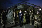 French President Emmanuel Macron wears a face mask during his visit at the military field hospital in Mulhouse, eastern France, Wednesday, March 25, 2020.