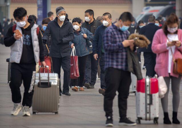 Touristes à la gare de Pékin