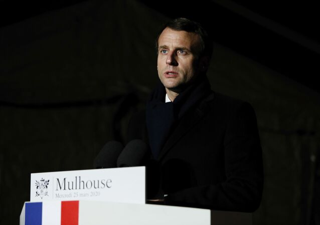 French President Emmanuel Macron speaks after visiting the military field hospital in Mulhouse, eastern France, Wednesday, March 25, 2020.