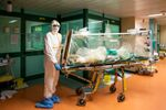Medical workers in protective suits transfer a coronavirus patient from the intensive care unit of the Gemelli Hospital to the Columbus Covid Hospital, which has been assigned as one of the new coronavirus treatment hospitals in Rome, Italy, March 16, 2020