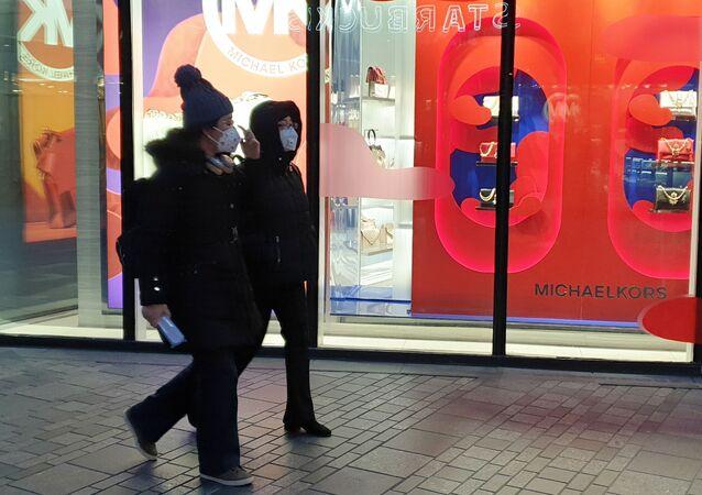 Des gens portant des masques à Pékin