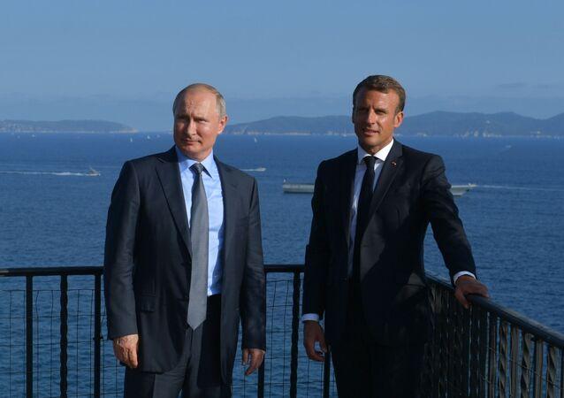 Vladimir Poutine et Emmanuel Macron (archives)