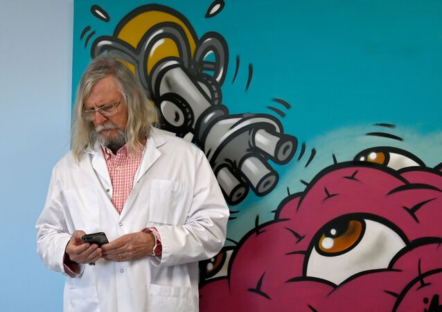 French professor Didier Raoult, biologist and professor of microbiology, specialized in infectious diseases and director of IHU Mediterranee Infection Institute poses in his office on 26 February 26, 2020 in Marseille. - The Mediterranee infection Institute in Marseille based in La Timone Hospital is at the forefront of the prevention against coronavirus in France. (Photo by GERARD JULIEN / AFP)
