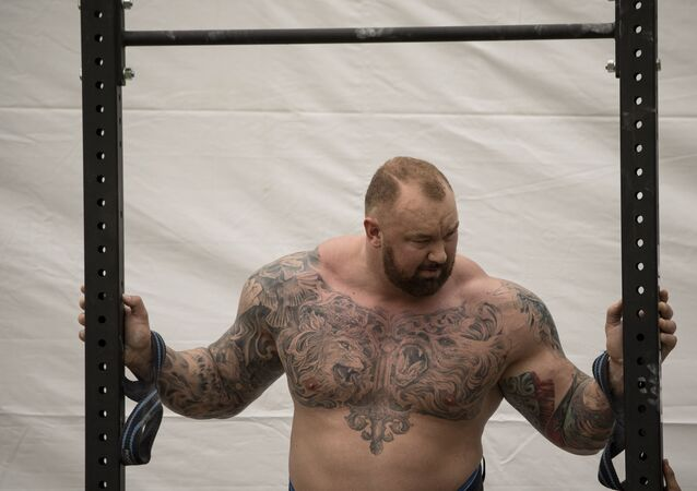 Hafthor Julius Bjornsson of Iceland rests before the Max Overhead competition of the 2018 World's Strongest Man in Manila on May 5, 2018. (Photo by NOEL CELIS / AFP)