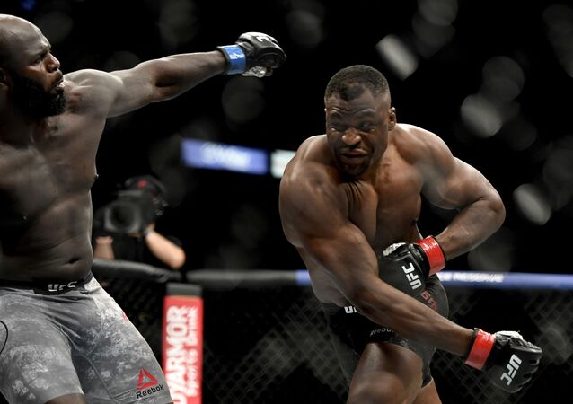 JACKSONVILLE, FLORIDA - MAY 09: Francis Ngannou (R) of Cameroon misses a punch against Jair Rozenstruik of Suriname in their Heavyweight fight during UFC 249 at VyStar Veterans Memorial Arena on May 09, 2020 in Jacksonville, Florida.   Douglas P. DeFelice/Getty Images/AFP