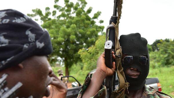 Des rebelles ivoiriens armés - Sputnik France