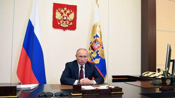 Vladimir Poutine lors d'une visioconférence - Sputnik France