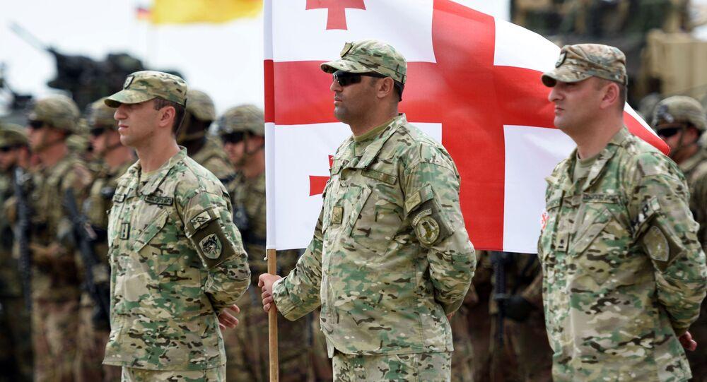 Des soldats géorgiens lors de la cérémonie d'inauguration d'exercices militaires sous l'égide de l'Otan en Géorgie