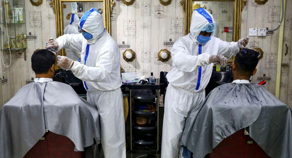 Des scientifiques alertent l'OMS sur la transmission du Covid-19 par l'air                REUTERS  Mohammad Ponir Hossain