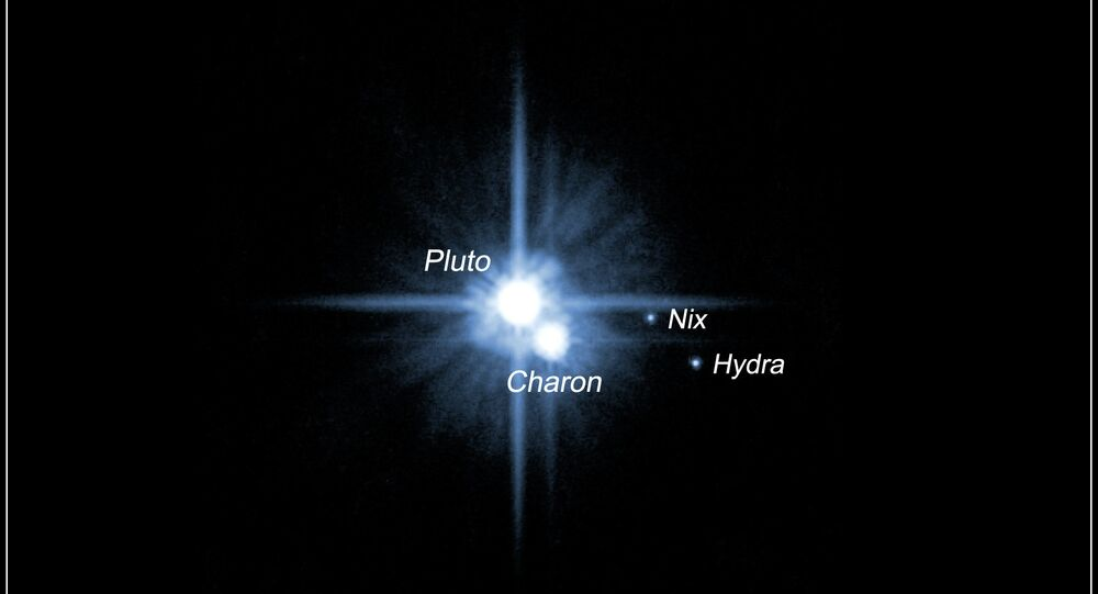 Pluton et ses satellites